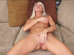 Blonde milf beauty gropes her tits and masturbates videos