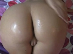 Big tits and a hot ass covered in slippery oil videos
