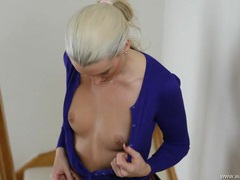 Beautiful blonde unbuttons her cardigan to tease her tits videos