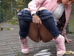 Short hair cutie in a sweater takes a public piss tubes