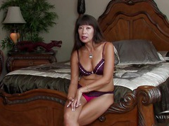 Asian mom in a sexy bra and panties chats with us videos