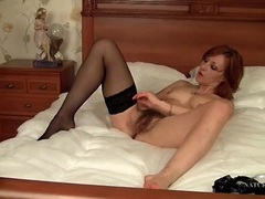 Tight ass and little tits on a masturbating milf redhead videos