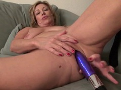 Horny mom has hot fun with her dildo movies at lingerie-mania.com