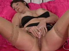 Stripping mature hottie plays with a sex toy videos