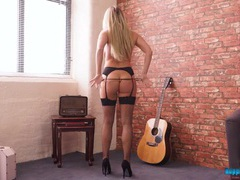 Black latex dress is amazing on this hot blonde videos