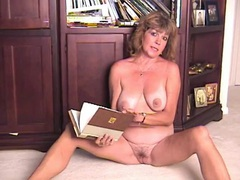Housewife strips in the home library to turn you on videos