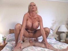 Gigantic fake breasts on a cock riding blonde girl videos