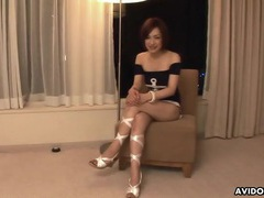 Elegant asian in a hotel room gives a naughty interview videos