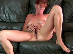 Sweet mature redhead and a little vibrator get it on movies at lingerie-mania.com