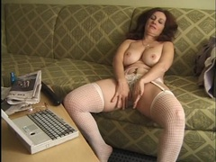 Redheaded mom in a hotel room for dildo fucking fun videos