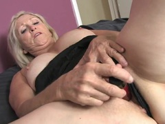 Freckled granny plunges a toy into her wet cunt tubes