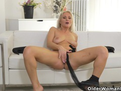 Blonde milf kathy peels off her black nylons and plays movies at adipics.com