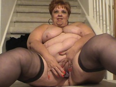 Fat old slut with a massive belly fucks a toy videos