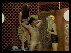Leather dommes spank his ass in a vintage femdom scene movies at freekilomovies.com