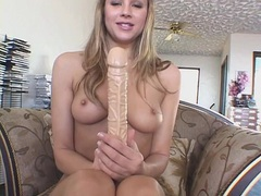 Cutie with a perfect pair of tits fucks a long dildo videos