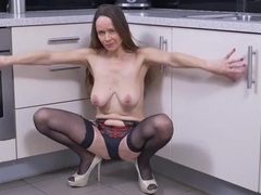 Slutty mature housewife in stockings teases videos