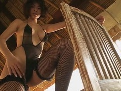 Oiled japanese girl in a bikini gets a sexy massage videos