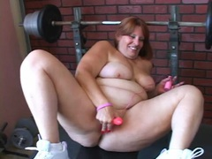Fatty works out and strips erotically in the gym videos