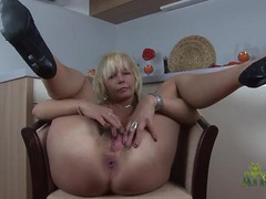 Blonde with a bush opens her legs and masturbates videos