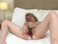 Hairy mature pussy looks mouth watering in bed movies at freekilopics.com