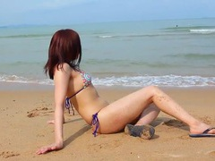 Sexy japanese model takes us to the beach for bikini fun movies at sgirls.net