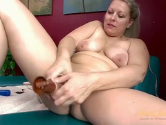Tight milf cunt opens for a dildo as she plays solo videos