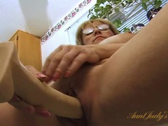 Old lady lubes her dildo and fucks her cunt videos