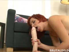 Redhead rotates between mouth and pussy with huge dildo movies at kilopills.com