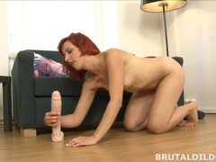 Redhead rotates between mouth and pussy with huge dildo movies at lingerie-mania.com