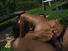 Double penetrating her brazilian holes in the garden movies at adipics.com