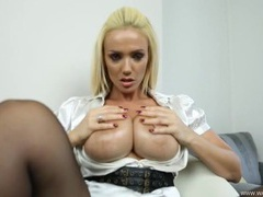 Big fake titties come out of her satin blouse to play videos