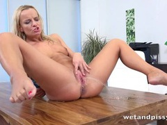Hot young blonde pours piss all over her body movies at freekiloclips.com