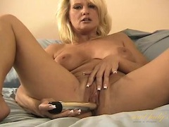Mom slowly slides a silver toy into her pussy videos