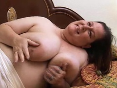 Bbw in bed plays with her massive natural tits videos