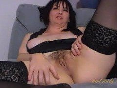 Black stockings make her milf legs look lovely movies at lingerie-mania.com