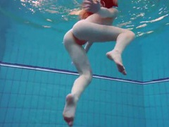 Swimming redhead strips underwater to tease us movies at kilomatures.com