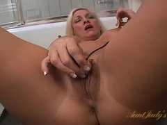 Mom on the bathroom floor plays with a vibrator movies at adipics.com