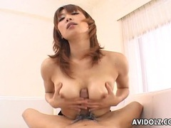 Asian oils up her breasts and gives a hot titjob tubes at asian.sgirls.net