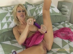 Glamorous blonde milf babe turned on by her toy videos
