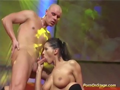 Busty babe fucked on public stage movies at kilopics.com