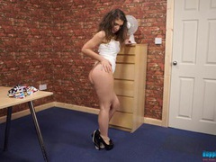 Beauty in a pleated skirt does her best striptease movies at freekiloclips.com